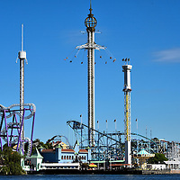 Gröna Lund Amusement Park in Stockholm, Sweden <br /> Welcome to Gröna Lund amusement park in the heart of Stockholm on the Djurgården islet that started in 1883.  Adrenalin junkies will love the three tower rides. On the right is Katapulten (Shot N' Drop Tower).  On the left is Fritt Fall Tilt (Giant Drop) that reaches 3.5 G-force as you plummet 262 feet. And real daredevils love the Eclipse (Giant Wave Swinger) in the middle where you spin around a 26 foot chain from a height of 400 feet.  Still not enough?  Then strap yourself into all seven of their rollercoasters. Have fun!