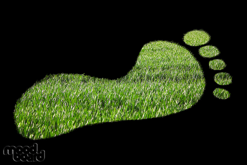 Close-up of green footprint over black background
