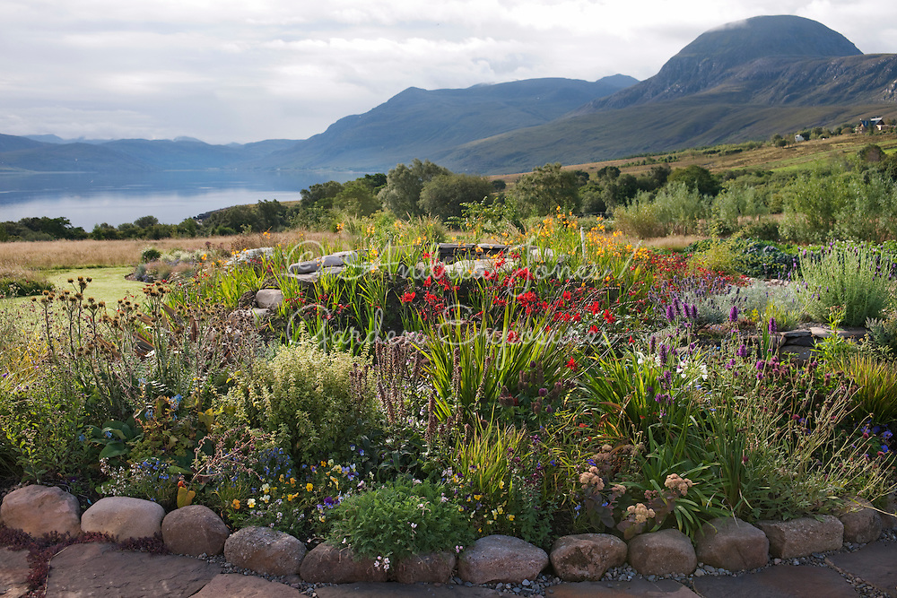 Paved area with border of herbs and flowering perennials<br /> <br /> <br /> 2 Durnamuck, Little Loch Broom, Wester Ross, Scotland