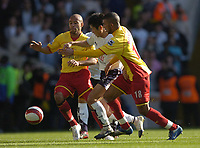Photo: Olly Greenwood.<br />Tottenham Hotspur v Watford. The Barclays Premiership. 17/03/2007. Tottenham's Young-pyo Lee is surrounded by Watford's James Chambers and Hameur Bouazza