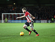 Brentford midfielder Alan Judge setting up an attack during the Sky Bet Championship match between Brentford and Middlesbrough at Griffin Park, London, England on 12 January 2016. Photo by Matthew Redman.