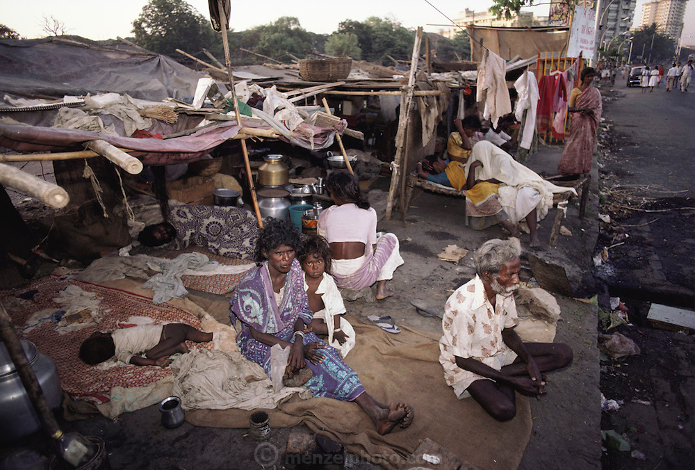 Poor people living on the sidewalk near Nariman Point; Bombay, India.