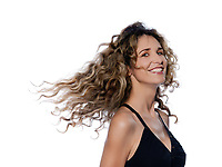 beautiful caucasian woman moving curly hair portrait isolated studio on white background