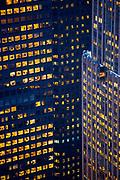 Midtown Manhattan office buildings at night.