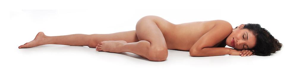 beautiful woman lying on white seamless background eyes open