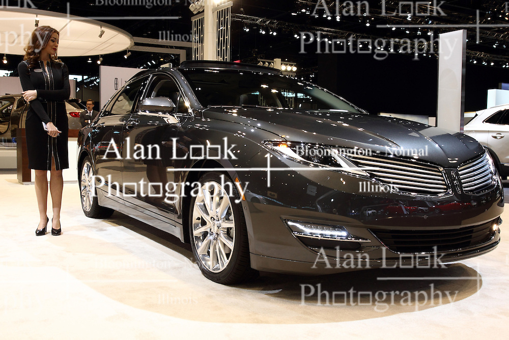 12 February 2015: 2015 LINCOLN MKZ: Marking a key milestone in Lincoln's reinvention is the dramatic 2015 Lincoln MKZ midsize luxury sedan. The MKZ was the first model created by the new Lincoln Design Studio. New for 2015 is available connectivity to the MyLincoln Mobile app. Connectivity is made possible through an available 3G embedded modem. There are four new exterior colors: Luxe, Magnetic, Bronze Fire and Guard. The exterior wears a sweeping roofline, steeply raked windshield, classic split-wing grille (first used on 1938 Lincoln-Zephyr), crafted LED headlights in sync with the steering wheel, and thin, full-width LED taillight graphic. Complementing the sophisticated body lines, the MKZ offers three distinct powertrains. Standard equipment includes 2.0-liter four-cylinder EcoBoost delivering 240 horsepower and a 20-percent increase in highway fuel economy. Next, the optional 3.7L V-6 produces 300hp that is 37hp more than the previous MKZ V-6 while improving fuel economy five-percent. When equipped for a trailer, the V-6 has a 2,000 pound tow capacity. Both of those engines utilize a push-button shift that replaces traditional mechanical transmission shift lever with a contemporary five-button interface, and can be match to models with either the front-wheel or all-wheel drive configurations. Innovation and technology abound inside all '14 MKZ, starting with MyLincoln Touch driver connect technology, push-button shift, remote start and a retractable panoramic roof that utilizes a 15.2-square-foot glass panel. The new MKZ is the only sedan in its class to offer inflatable second-row outboard seat belts, and the available THX II car audio system is a Lincoln-exclusive that contains 700 watts, 14 channels and 14 speakers. Finally, the well-tailored truck provides an ample 15.4 cu. ft. of luggage room.<br /> <br /> First staged in 1901, the Chicago Auto Show is the largest auto show in North America and has been held more times than any other auto exposition on the continent