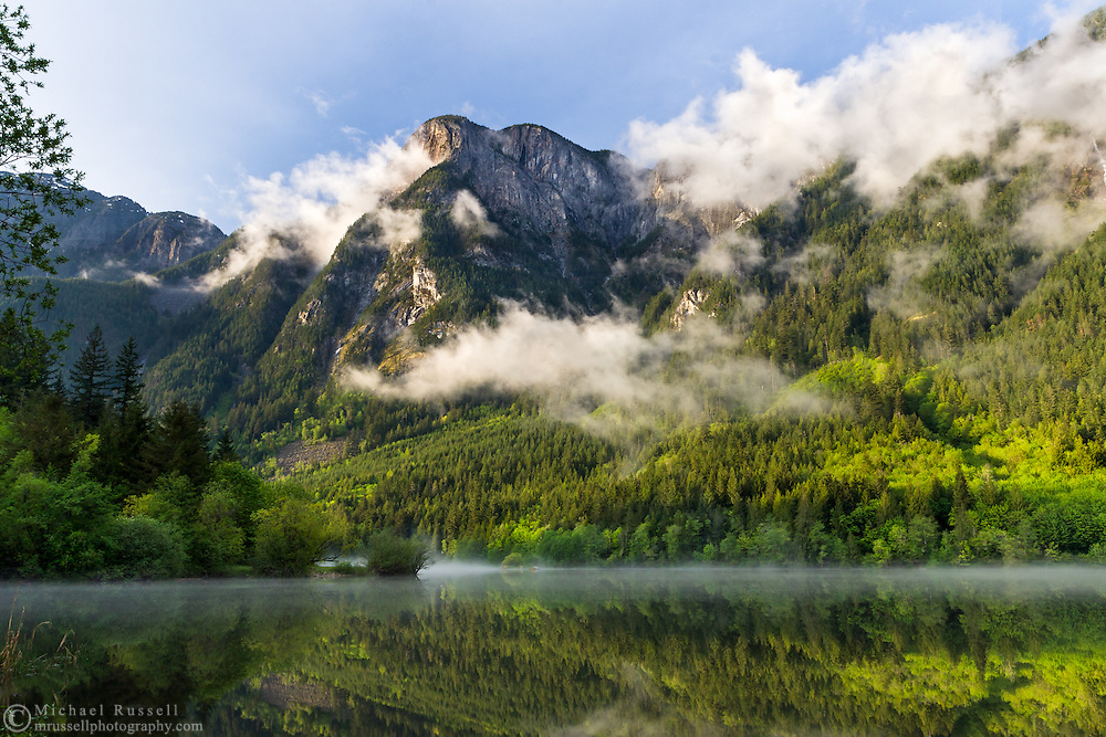 Clouds clear from Hope Mountain after a storm in Silver Lake Provincial Park near Hope, British Columbia, Canada