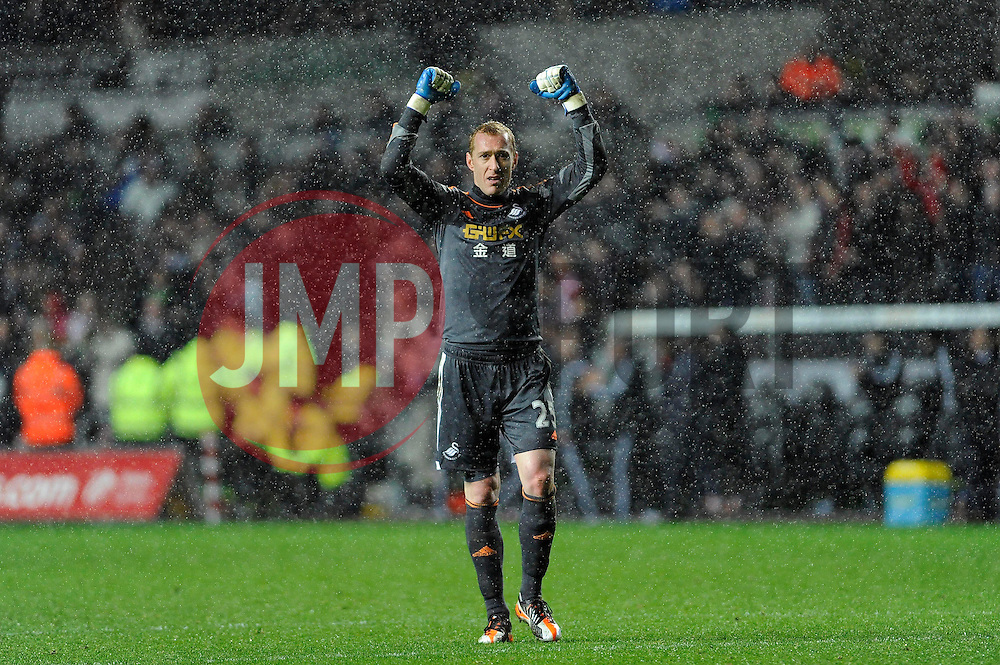 Swansea City's Gerhard Tremmel celebrates Swansea's goal - Photo mandatory by-line: Dougie Allward/JMP - Tel: Mobile: 07966 386802 22/12/2013 - SPORT - FOOTBALL - Liberty Stadium - Swansea - Swansea City v Everton - Barclays Premier League