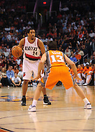 Mar. 21 2010; Phoenix, AZ, USA; Portland Trailblazers guard Andre Miller (24) is guarded by Phoenix Suns guard Steve Nash (13) in the first half at the US Airways Center.   Mandatory Credit: Jennifer Stewart-US PRESSWIRE.