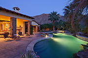 Swimming pool in luxury villa at evening with mountain in background