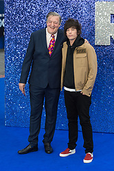 May 20, 2019 - London, England, United Kingdom - Stephen Fry (L) and Elliott Spencer arrive for the UK film premiere of 'Rocketman' at Odeon Luxe, Leicester Square on 20 May, 2019 in London, England. (Credit Image: © Wiktor Szymanowicz/NurPhoto via ZUMA Press)