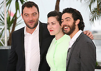 Actor, Denis Menochet, Director, Rebecca Zlotowski and Actor, Tahar Rahim at the Grand Central film photocall at the Cannes Film Festival 18th May 2013