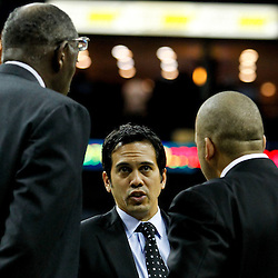 October 13, 2010; New Orleans, LA, USA; Miami Heat head coach Erik Spoelstra (center) talks with his assistants during the second half of a preseason game against the New Orleans Hornets at the New Orleans Arena. The Hornets defeated the Heat 90-76. Mandatory Credit: Derick E. Hingle