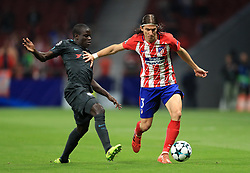 Chelsea's N'Golo Kante (left) and Atletico Madrid's Filipe Luis battle for the ball