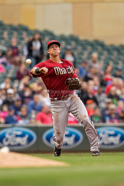 MINNEAPOLIS, MN- SEPTEMBER 24: Jake Lamb #19 of the Arizona Diamondbacks throws against the Minnesota Twins on September 24, 2014 at Target Field in Minneapolis, Minnesota. The Twins defeated the Diamondbacks 2-1. (Photo by Brace Hemmelgarn) *** Local Caption *** Jake Lamb