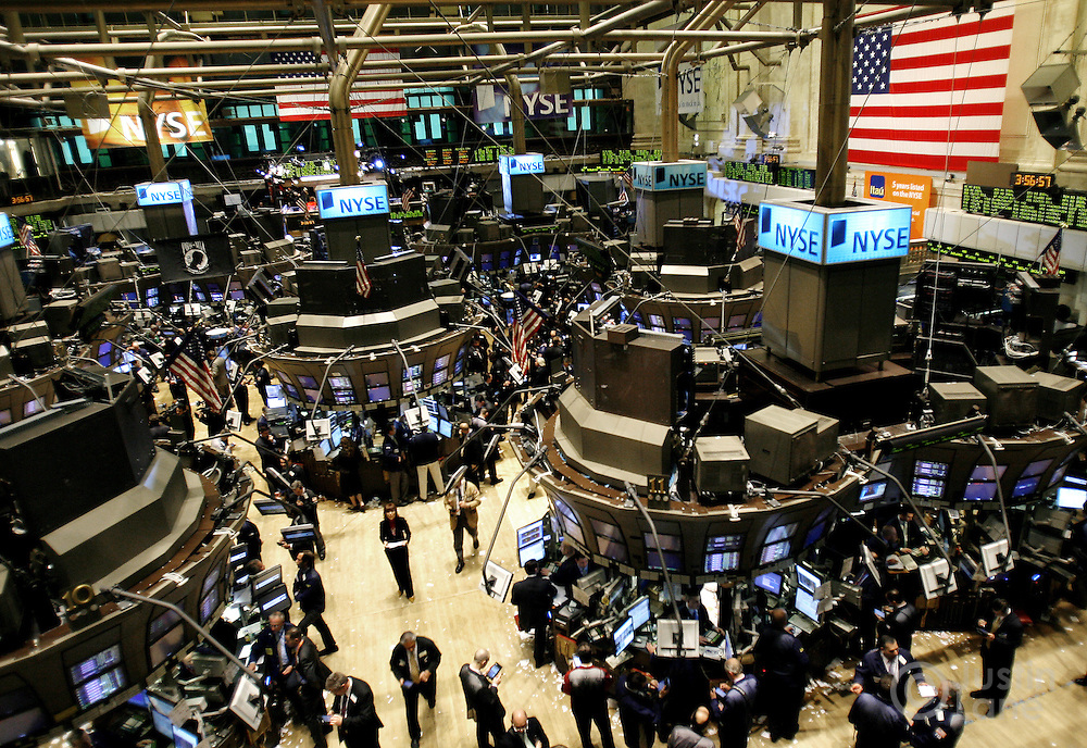 Traders work on the floor of the New York Stock Exchange at the end of trading in New York, New York on Thursday 01 March 2007.  The Dow Jones industrials ended down 34 points after falling 209 points in early in the day.