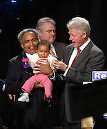 EDS NOTE: CHILDS NAME NOT AVAILABLE: PHILADELPHIA - OCTOBER 31: Philadelphia Mayor John F. Street (L), holds his grandchild as former U.S. President Bill Clinton holds the childs hand during a rally in support of Democratic Philadelphia Mayor John F. Street October 31, 2003 in Philadelphia, Pennsylvania. According to polls, Street has been helped by the FBI's probe into corruption in Philadelphia government. Street faces Republican Sam Katz in the Nov. 4th Mayoral election. (Photo by William Thomas Cain/Getty Images)
