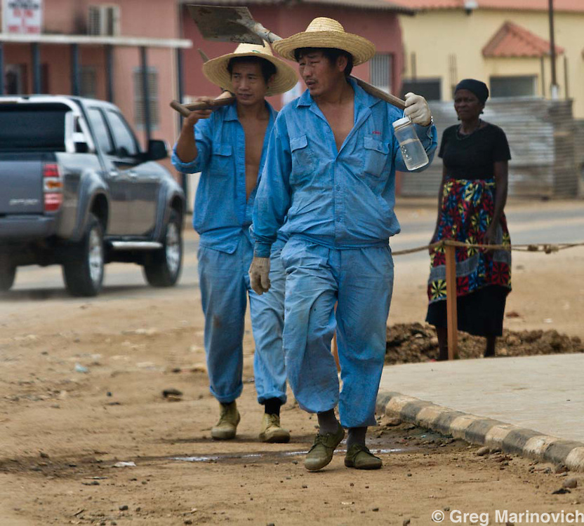 CAIXITO, ANGOLA SEPT 30: 2007:  Chinese workers of CMEC company lay fixed telephone cables in the northern town of Caixito, Sept 30, 2007. Chinese construction and technical workers are everywhere to be seen in this former war-ravaged country.   Photo Greg Marinovich