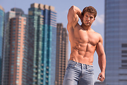 shirtless muscular man against a cityscape background
