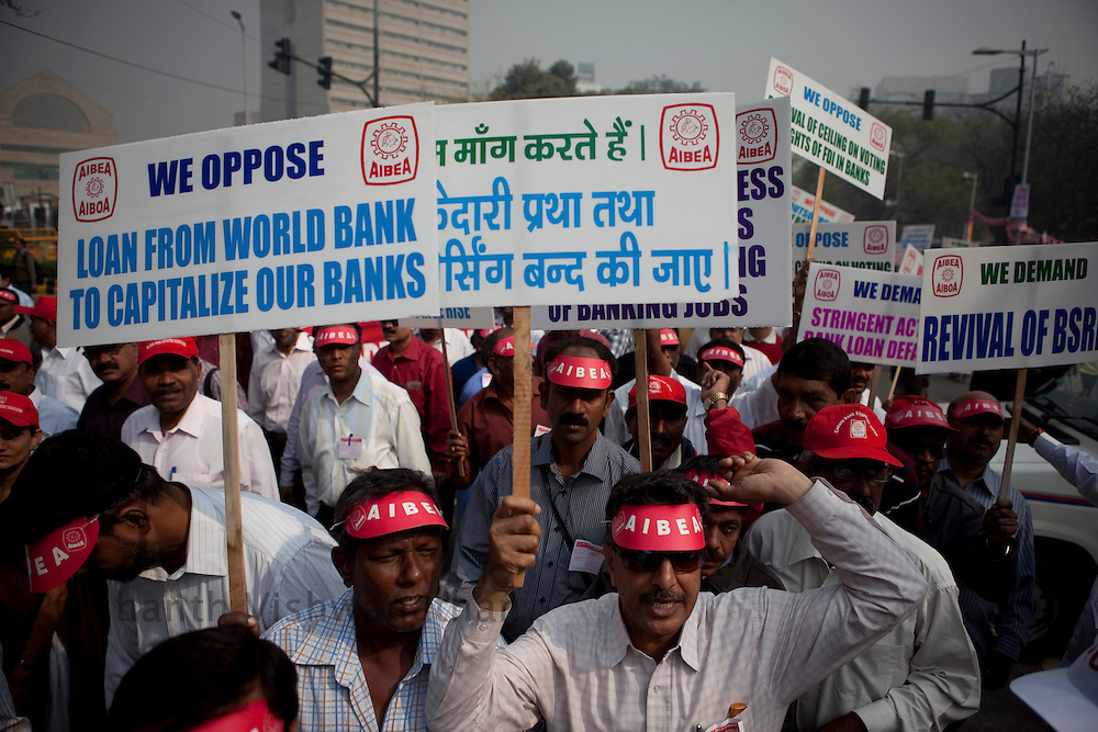 Workers from trade unions across the country carry placards while on a march to the parliment street protesting against rising food prices, low wages and job security, New Delhi, India, on Wednesday, February 23, 2011. Photographer: Prashanth Vishwanathan/Bloomberg News