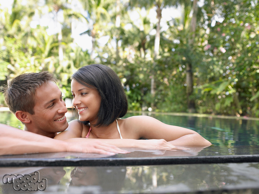 Young Couple in Swimming Pool
