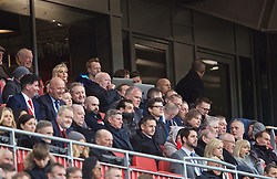 LIVERPOOL, ENGLAND - Sunday, March 31, 2019: Tottenham Hotspur' manager Mauricio Pochettino, hidden behind a laptop, watches from the stands as he serves s touch-line ban during the FA Premier League match between Liverpool FC and Tottenham Hotspur FC at Anfield. (Pic by David Rawcliffe/Propaganda)