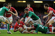 Jamie Roberts of Wales is tackled by Ireland's Rory Best. RBS Six nations championship, Wales v Ireland at the Millennium stadium in Cardiff, South Wales on Saturday 2nd Feb 2013. pic by Andrew Orchard, Andrew Orchard sports photography,