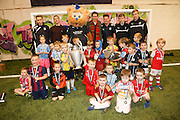 Dundee players Cammy Kerr (back row second left) and Matty Allan (back row fourth left) as well as mascot Deewok were on hand to present medals, books and match tickets to all the kids who took part on Dundee FC in the Community Champions League Finals night - Dundee FC in the Community kids Champions League finals at Manhattan Works<br /> <br />  - &copy; David Young - www.davidyoungphoto.co.uk - email: davidyoungphoto@gmail.com