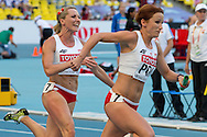 (L) Ewelina Ptak and (R) Marta Jesche both from Poland compete in women's relay 4x100 meters qualification during the 14th IAAF World Athletics Championships at the Luzhniki stadium in Moscow on August 18, 2013.<br /> <br /> Russian Federation, Moscow, August 18, 2013<br /> <br /> Picture also available in RAW (NEF) or TIFF format on special request.<br /> <br /> For editorial use only. Any commercial or promotional use requires permission.<br /> <br /> Mandatory credit:<br /> Photo by © Adam Nurkiewicz / Mediasport