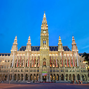 Panoramic shot of Vienna's imposing Rathaus (City Hall) at dusk.