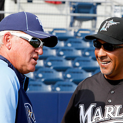 March 15, 2011; Port Charlotte, FL, USA; Tampa Bay Rays manager Joe Maddon (70) and Florida Marlins manager Edwin Rodriguez (36) talk before a spring training exhibition game at Charlotte Sports Park.   Mandatory Credit: Derick E. Hingle