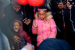 Hundreds of fans, friends and family mourn at a vigil for battle rapper Akeem Mickens (professionally known as Tech9) at the Happy Hollow playground, in Germantown, on Tuesday. (Bastiaan Slabbers for WHYY)