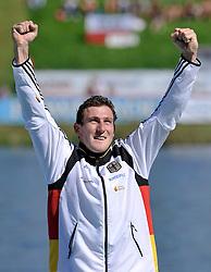 SEBASTIAN BRANDEL (GERMANY) CELEBRATES HIS GOLD MEDAL IN MEN'S C1 1000 METERS FINAL A RACE DURING 2010 ICF KAYAK SPRINT WORLD CHAMPIONSHIPS ON MALTA LAKE IN POZNAN, POLAND...POLAND , POZNAN , AUGUST 21, 2010..( PHOTO BY ADAM NURKIEWICZ / MEDIASPORT ).