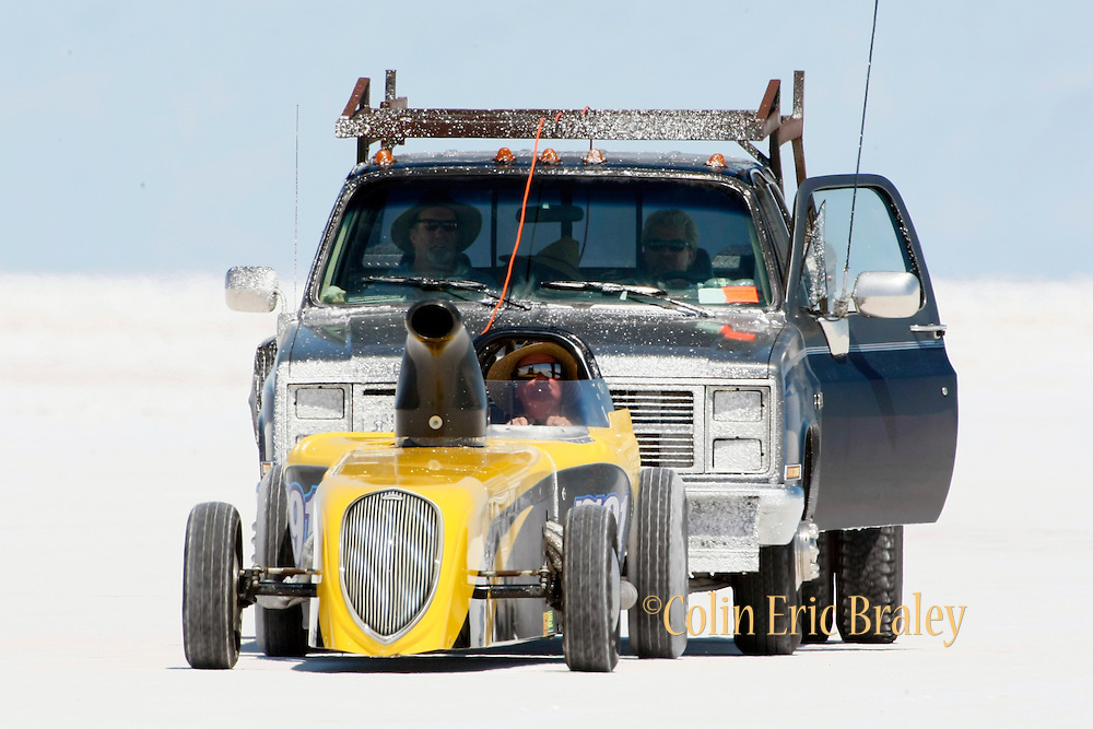 Best cars-people-atmosphere-photos of 2009 Bonneville Speed Week- The Tequila Sunrise IV, a 1932 American Bantam Roadster, out of Martinez, CA. is pushed back to the pit area after making a run at the Bonneville Speed Way. August 9, 2009.  Photo by Colin E. Braley
