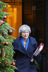 © Licensed to London News Pictures. 19/12/2018. London, UK. British Prime Minister Theresa May departs from Number 10 Downing Street to attend the last Prime Minister's Questions (PMQs) of 2018 in the House of Commons. Photo credit: Dinendra Haria/LNP