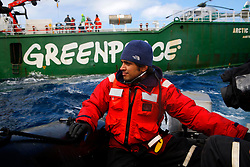 ATLANTIC OCEAN ABOARD ARCTIC SUNRISE 21MAY11 - Boat driver MiguelArguelles of Mexico near the Arctic Sunrise in the north Atlantic.....Photo by Jiri Rezac / Greenpeace