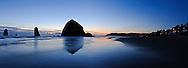 Haystack Rock mirrored in sand,  Tolovana Beach State Recreation Site, Cannon Beach, Oregon, USA
