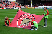 Walsall fans holding the clubs flag during the Sky Bet League 1 match between Walsall and Doncaster Rovers at the Banks's Stadium, Walsall, England on 12 September 2015. Photo by Alan Franklin.