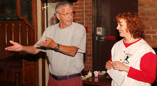 "Tamra Francis as Lee Pepper (right) with an audience member during Mayhem & Mystery's production of ""Baseball Battle"" at the Spaghetti Warehouse in downtown Dayton, Monday, May 7, 2012."