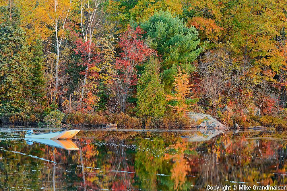 Boat on Raven Lake in autumn <br /> Raven Lake near Dorset<br /> Ontario<br /> Canada