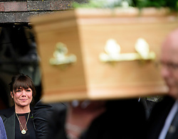 © Licensed to London News Pictures. 18/04/2016. Shirley, UK.  Ronnie Corbett's daughter Sophie watches as the coffin carrying her father leaves the church after  hthe funeral of comedian, actor, writer Ronnie Corbett, held at St John the Evangelist Church in Shirley near Croydon. Corbett, who was most famous for his comedy sketch show  The Two Ronnies, performed with the late Ronnie Barker, died at the age of 85. Photo credit: Ben Cawthra/LNP