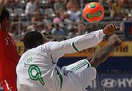 Football-FIFA Beach Soccer World Cup 2006 - Group D-BHR_NGA - Agu-NGA_ performs a side kick.. - Rio de Janeiro - Brazil 06/11/2006<br />Mandatory credit: FIFA/ Marco Antonio Rezende.