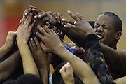 Benson Boys High School basketball player player Martin Moore pumps up his teammates during a timeout of a double-overtime win over Lincoln.