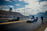 April 22-24, 2016: NHRA 4 Wide Nationals: Courtney Force, Funny Car, Chevy is pushed back to the start after doing a burnout.