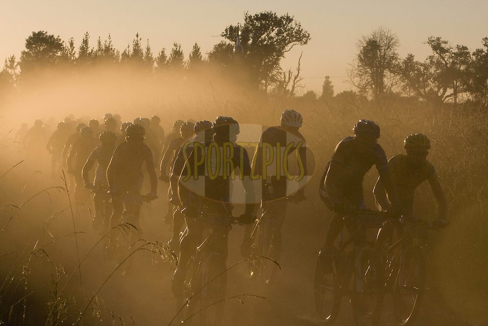 WESTERN CAPE, SOUTH AFRICA -  30 March 2008, Sunrise during stage two of the 2008 Absa Cape Epic Mountain Bike stage race from Saasveld Campus Nelson Mandela Metropolitan University in George to Calitzdorp Spa, Calitzdorp in the Western Cape, South Africa...Photo by Karin Schermbrucker/SPORTZPICS