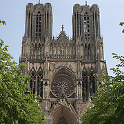 The main approach to Notre Dame de Reims. <br /> <br /> Notre Dame de Reims was built after Notre Dame de Paris, so it represents the pinnacle of gothic architecture in France. At first glance, it might look the same, but there are differences both outside and in.  <br /> <br /> This cathedral was the sight for the coronation of 13 French Kings, and was nearly destroyed in both World Wars - Axis forces used it as an artillery magnet during WW I - so it's no small miracle it survives today.