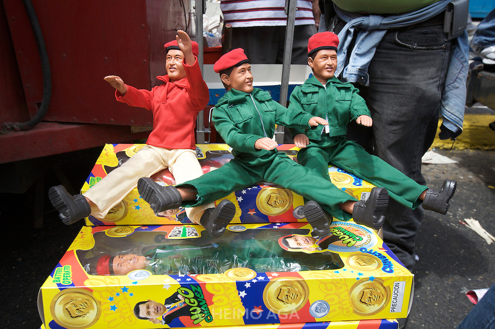 Supporters of Hugo Chavez celebrating the sixth anniversary of the failed coup against Chavez in the historic Center of Caracas. Chavez souvenir dolls.