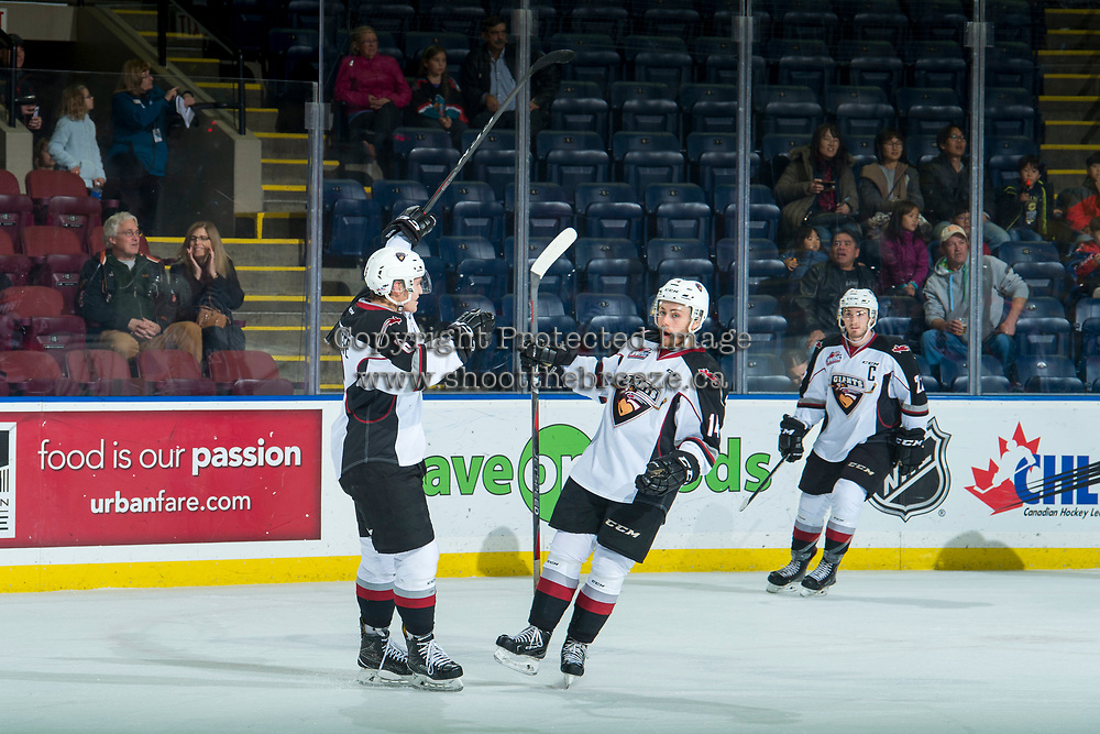 KELOWNA, CANADA - OCTOBER 3: Dylan Plouffe #6 and James Malm #14 of the Vancouver Giants celebrate a first period goal against the Kelowna Rockets  on October 3, 2018 at Prospera Place in Kelowna, British Columbia, Canada.  (Photo by Marissa Baecker/Shoot the Breeze)  *** Local Caption ***
