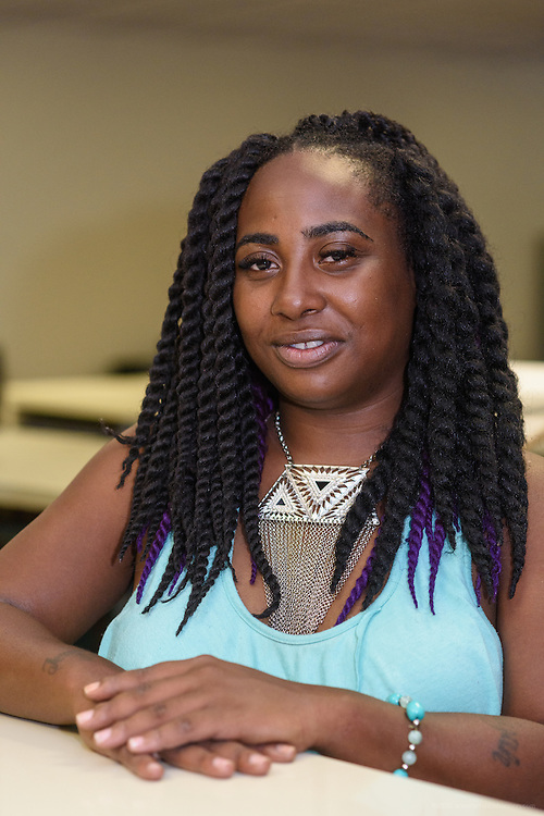 Katrice Gill, 28, a communications major/ social justice minor at Jefferson Community and Technical College, in the Smith Library. (Photo by Brian Bohannon)