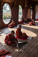 Shwe Yan Pyay Monastery in Nyaung Shwe near Inle Lake is a wooden monastery with unique red painted teak wood oval windows.  The temple is richly decorated with mosaics and golden ornaments. The unique oval windows at this teak monastery serves as a school for young Burmese novice monks.